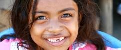 Close no sorriso de uma criança  / Crédito: UN Photo/Martine Perret